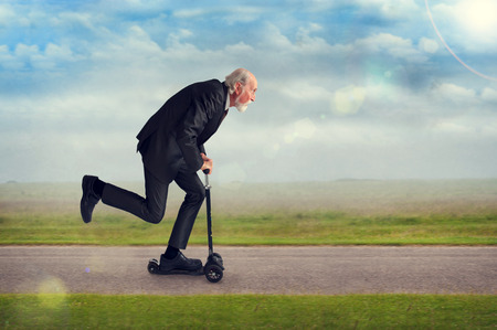 senior man riding a scooter active and energetic