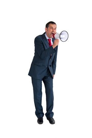 loudhailer: hombre de negocios enojado con el meg�fono aislado en blanco Foto de archivo