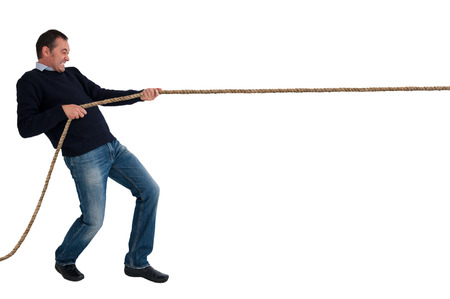 man pulling a rope tug of war isolated white background