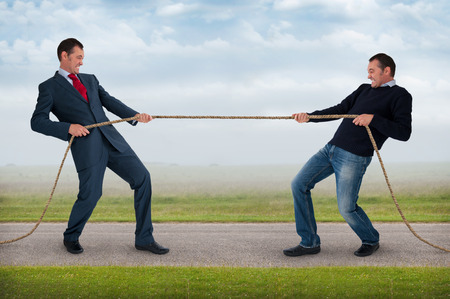 endeavor: tug of war work life balance conflict concept Stock Photo