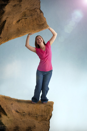 heavy risk: woman stressed and constrained trapped by a heavy weight  Stock Photo
