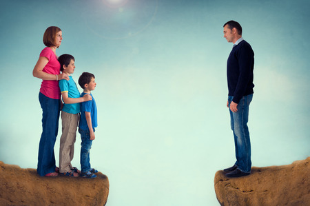 chasm: divorce concept family separation man woman and children separated by a chasm