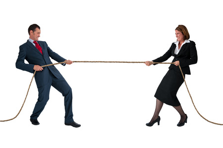 struggling: businessman and woman tug of war rivalry concept isolated on white
