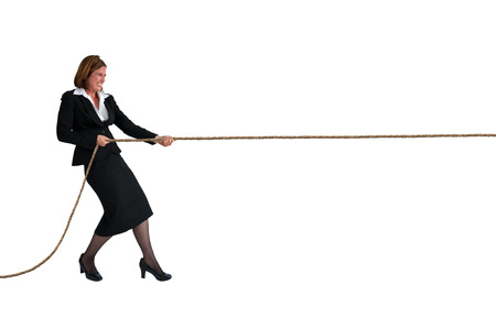 straining: businesswoman pulling a rope business concept isolated on white Stock Photo