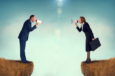 business concept conflict megaphone businessman and businesswoman Standard-Bild