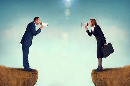 business concept conflict megaphone businessman and businesswoman Standard-Bild