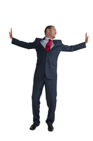 outwards: businessman pushing outwards isolated on a white background Stock Photo