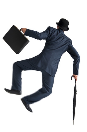 businessman jumping and kicking his heels isolated on white background photo