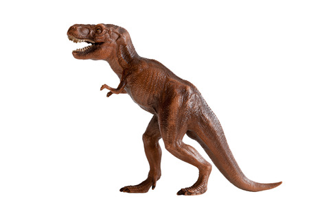 isolated white: tyrannosaurus rex dinosaur plastic toy isolated on white background Stock Photo