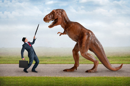 takeover: hostile business takeover concept businessman and tyrannosaurus