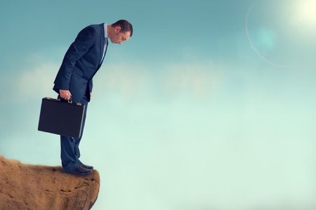 edge of cliff: businessman gap worry fear obstacle