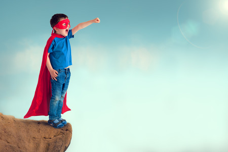 dressing up costume: superhero child Stock Photo