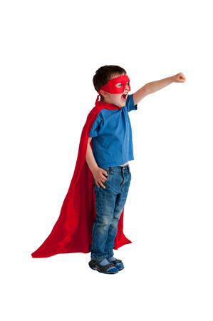 dressing up costume: superhero boy child isolated on white