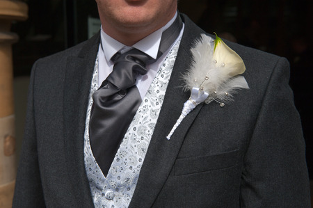 diamante: groom with lily buttonhole flower