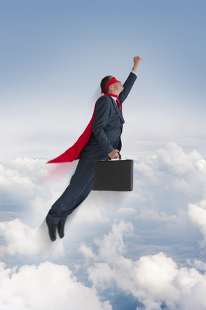 exceeding: superhero businessman flying upwards in the sky