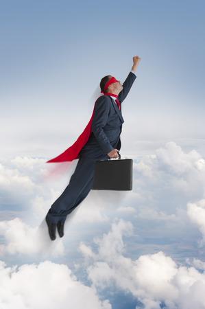 men in suit: superhero businessman flying upwards in the sky