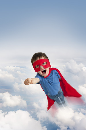 superhero boy flying in the sky through clouds