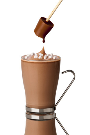 stirrer: hot chocolate drink with marshmallows made with a chocolate stirrer