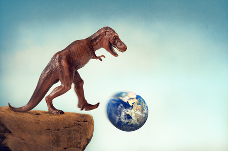 dinosaur kicking the planet earth off a precipice with motion blur and vintage filter