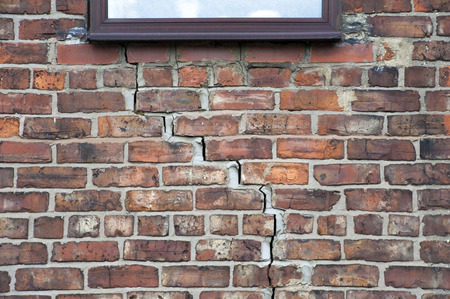 structural: step cracking damage to brickwork in a wall beneath a window as a result of subsidence