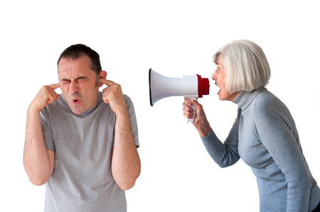 intimidate: man being yelled at by senior woman on white