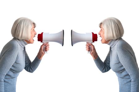 senior woman shouting at herself 版權商用圖片
