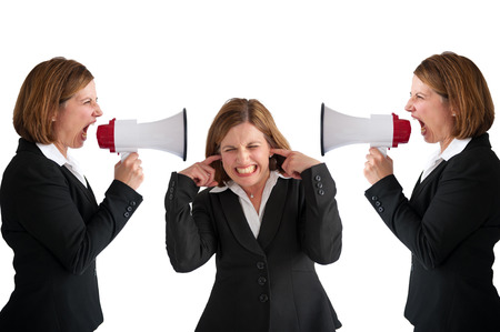 loudhailer: businesswoman being shouted at by businesswomen with megaphone
