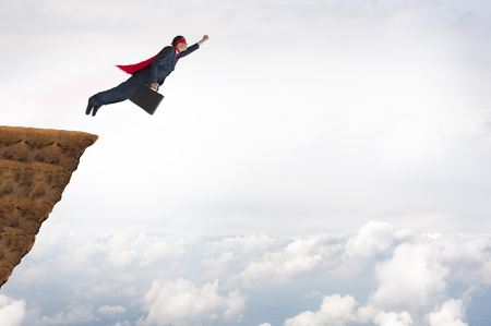 business success concept superhero businessman flying Stock Photo