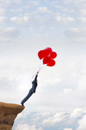 business risk concept courageous daring businessman holding balloons Stock Photo