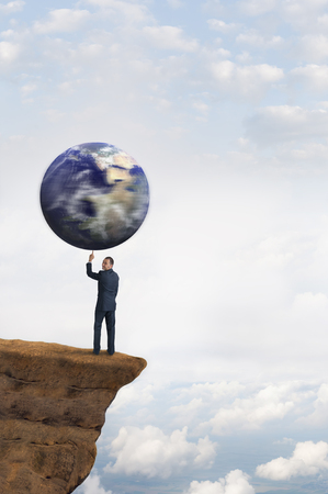 lifting globe: global business concept businessman spinning earth on one finger Stock Photo