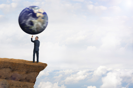 one finger: global environmental business concept businessman spinning earth on one finger Stock Photo