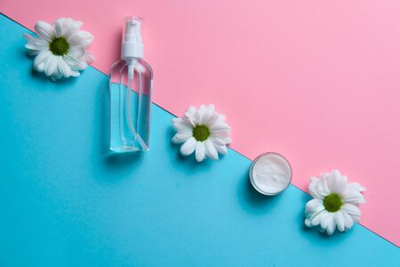 Chamomile cosmetics line showed on two colored backdrops, trendy cosmetic line commercial advertisement for cream fragrance antiseptic line
