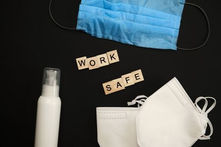 safety first concept with personal protection for workers on bright background