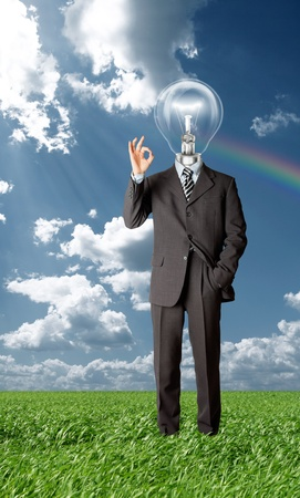 happy businessman with lamp-head holding blank white card in his hands outdoors photo