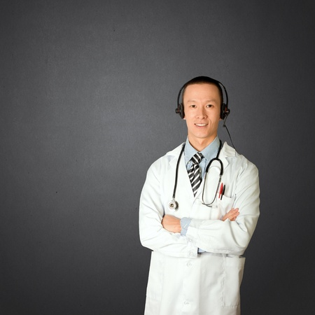 asian doctor with headphones, lab coat and stethoscope Stock Photo - 8891720