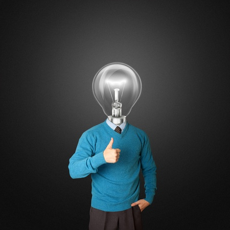 young businessman with lamp-head shows well done photo