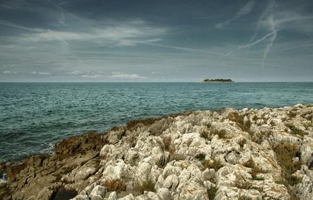 uninhabited: adriatic seas uninhabited island with beautiful sky