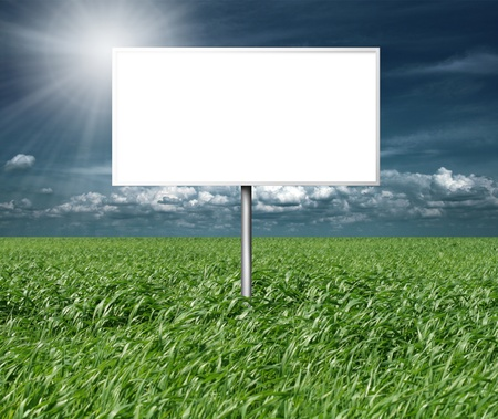 billboard and green grass and blue cloudly sky with sun Stock Photo - 8992516