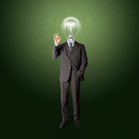 full length business male with lamp-head in suit shows OK photo