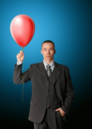 birthday suit: businessman in suit with the balloon
