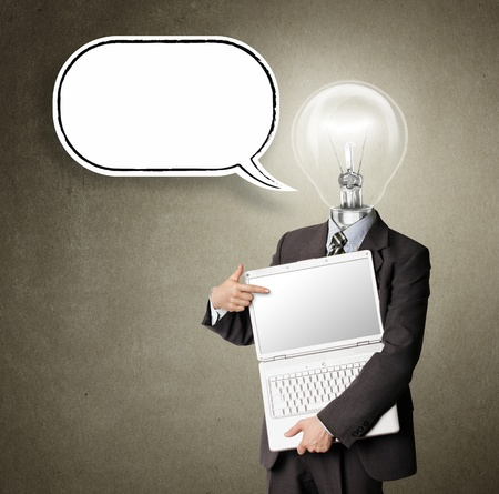in thought: businessman with lamp-head and laptop and comics bubble shows something with his finger