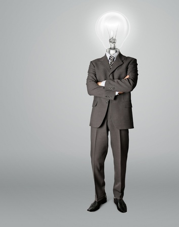 businessman with lamp-head have got an idea photo