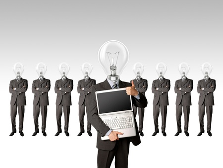 male businessman with lamp-head and laptop have got an idea photo