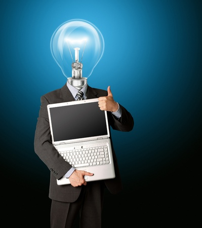 businessman with lamp-head with open laptop shows welldone Stock Photo - 8992826