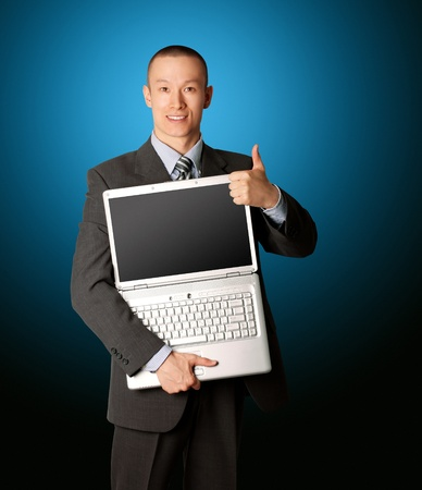 businessman in expensive suit with open laptop shows welldone photo