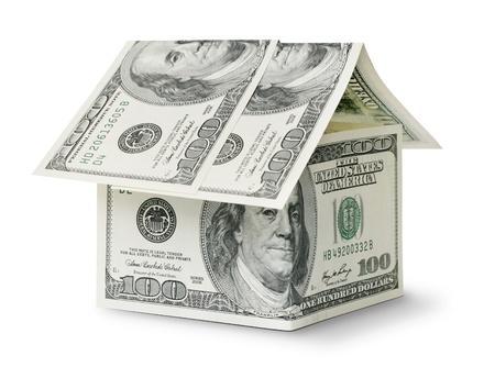 flujo de dinero: d�lar en casa de forma aislada sobre fondo blanco