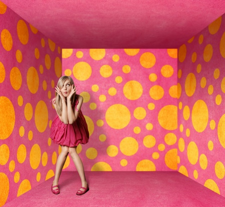 nude blond girl: surprised blonde in pink dress in pink room Stock Photo