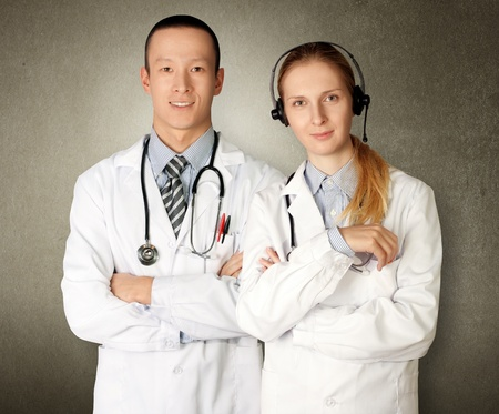 two doctors smiles at camera isolated on different backgrounds photo
