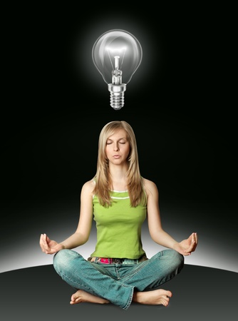 woman meditation in yoga pose with bulb isolated Stock Photo - 8992633