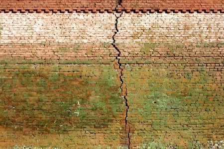 old brick wall, close up, with big crack, weathered Stock Photo - 9094332